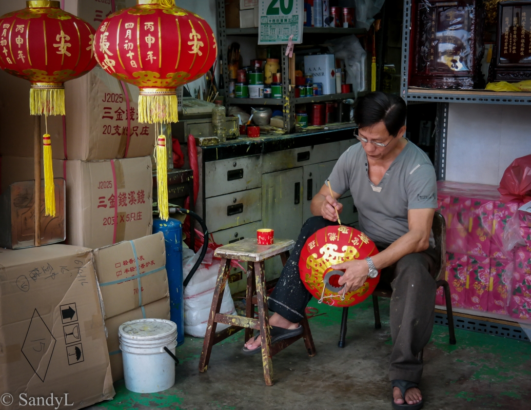 Man painting red latern for Chinese New Year