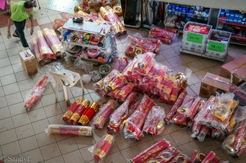 Paper merchant preparing Chinese lanterns for sale