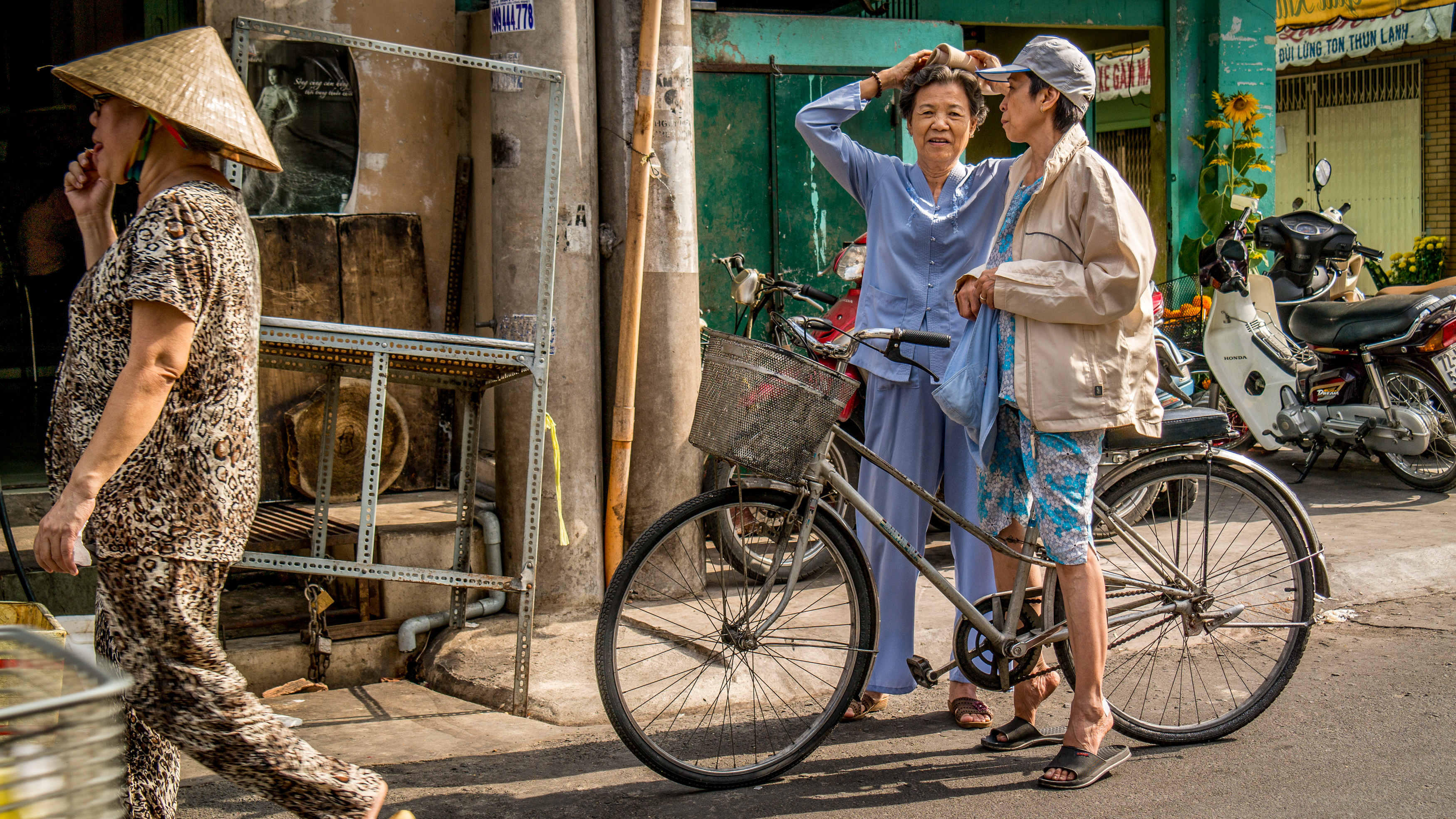 Saigon street scene with three ladies in Cholon market