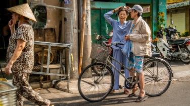 Saigon street scene with three ladies in Cholon market