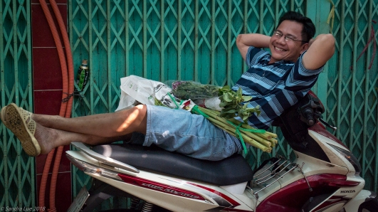 Moto man in Saigon's Flower Market, Vietnam
