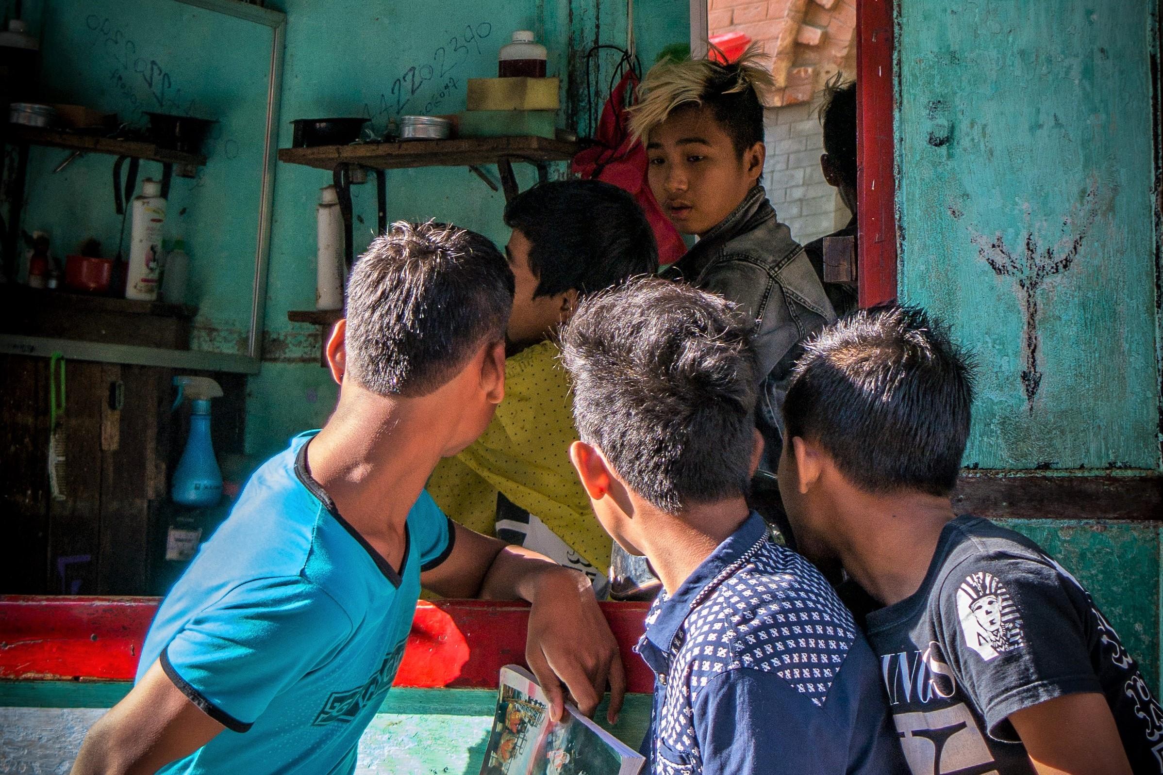 Boys outside a barber shop in Bagan Myanmar