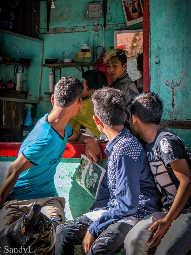 Boys outside barber shop in Bagan Myanmar