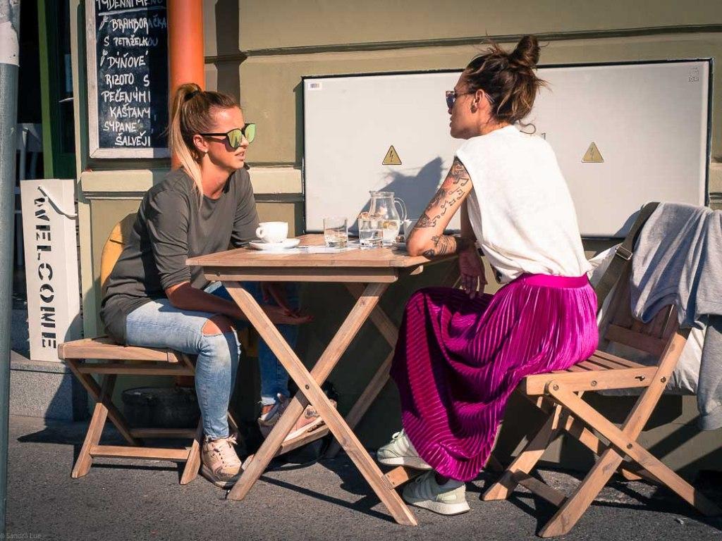 Two ladies on side walk cafe in Prague