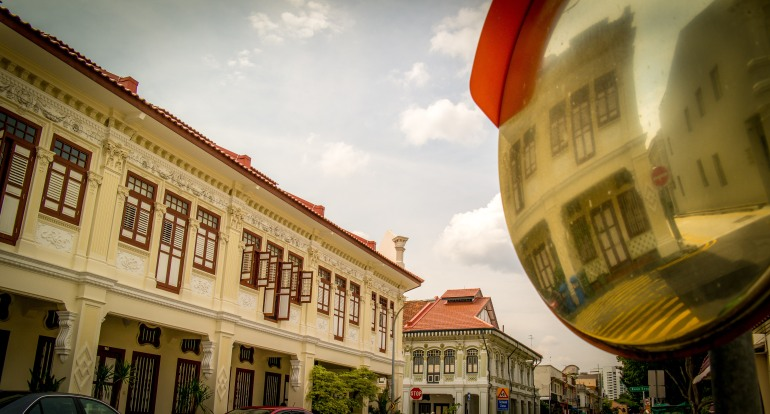 Singapore shop houses with a view from a traffic mirror